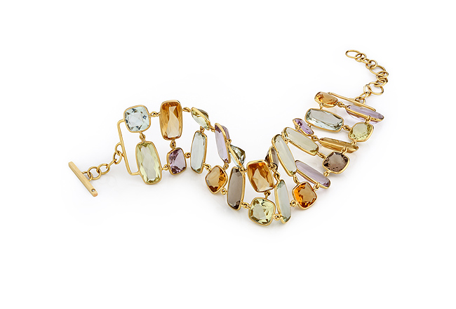 18 carat gold bracelet with real natural gems