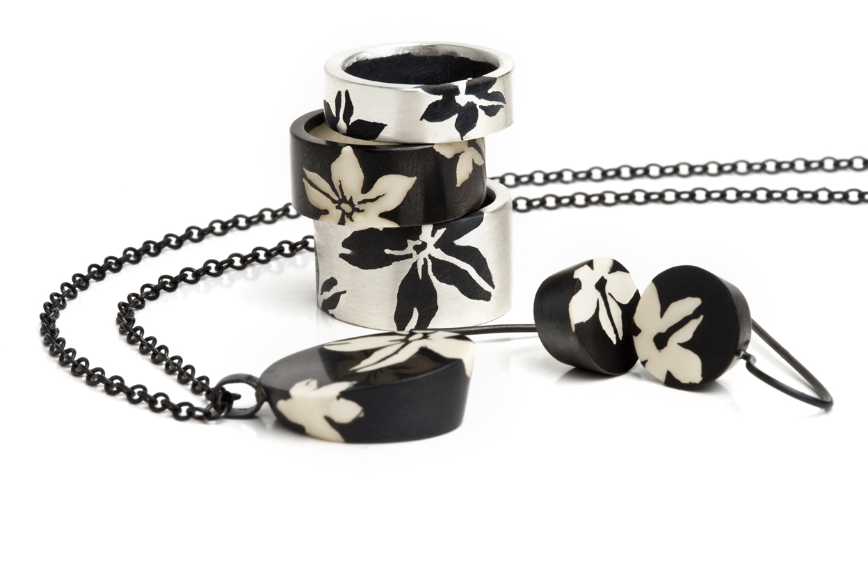 silver jewelry with graphic flowers