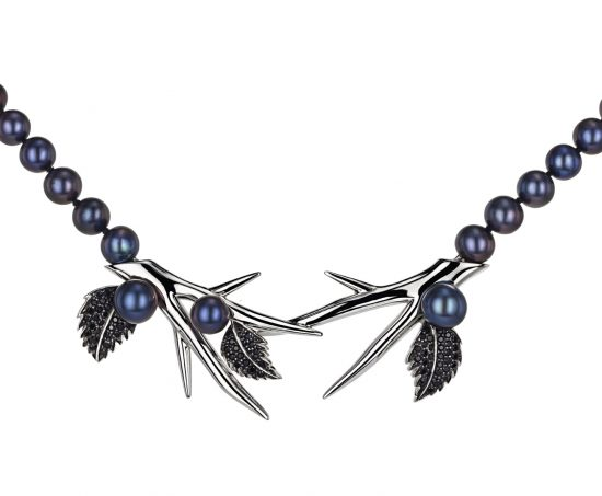Pearl necklace with silver branches and leaves with black gems.