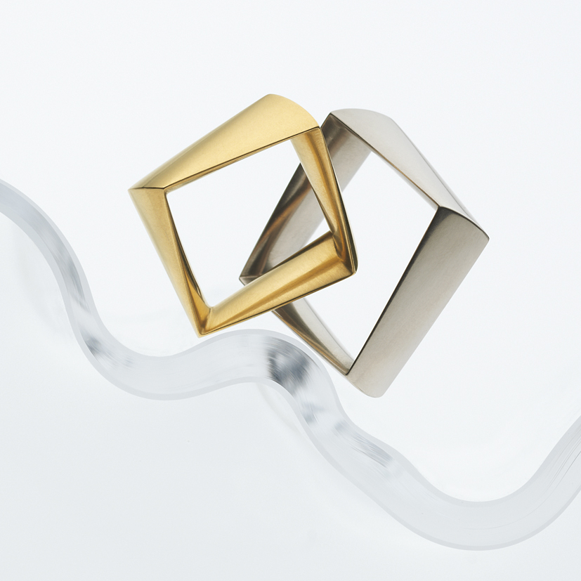 """angular"" but very comfortable fitting golden wedding rings"