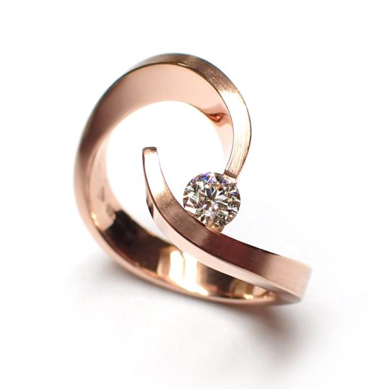 artistic 18 carat rose gold ring with a brilliant cut diamond
