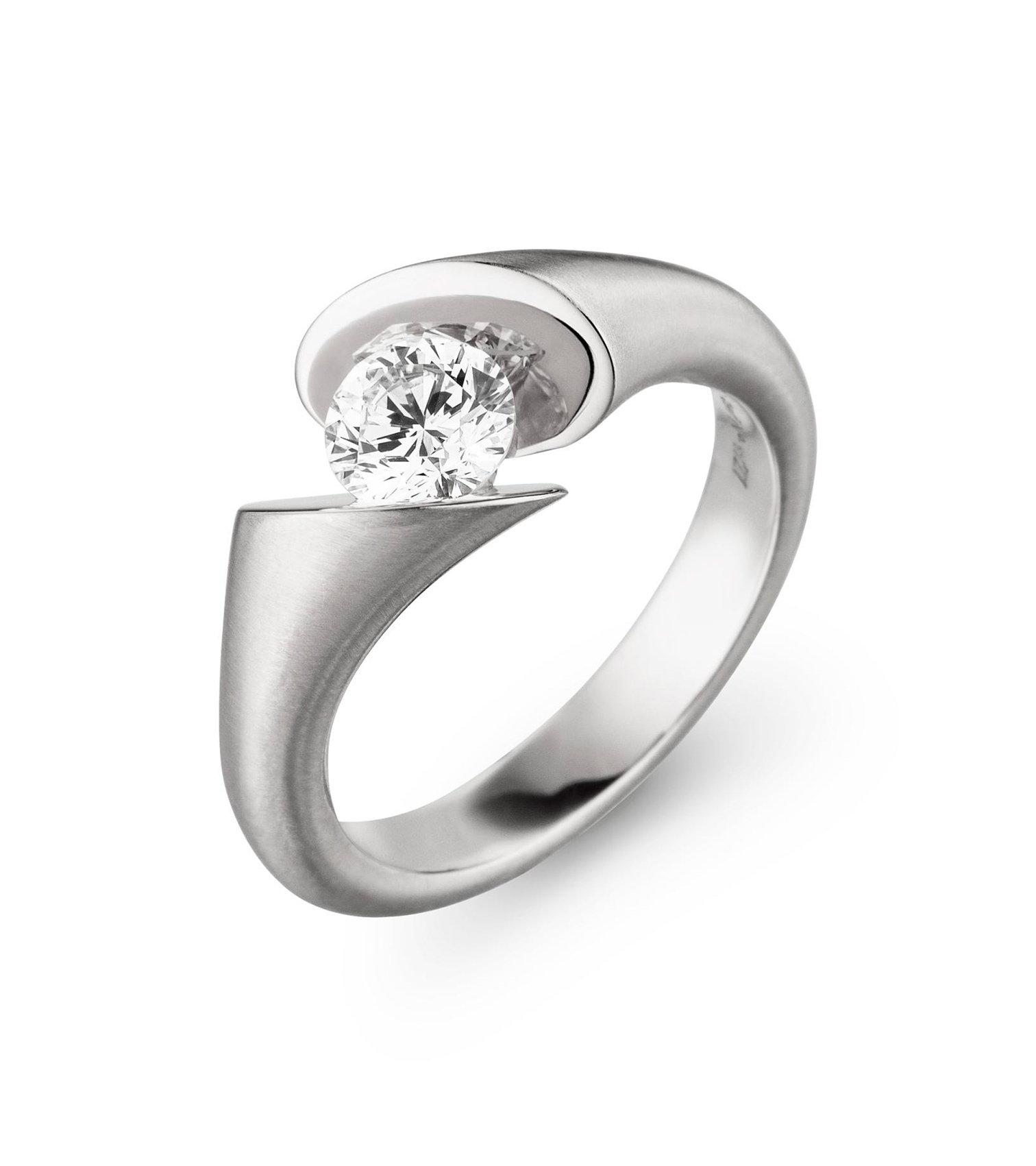 Engagement ring, or just a beautiful ring, with a natural, brilliant cut diamond.