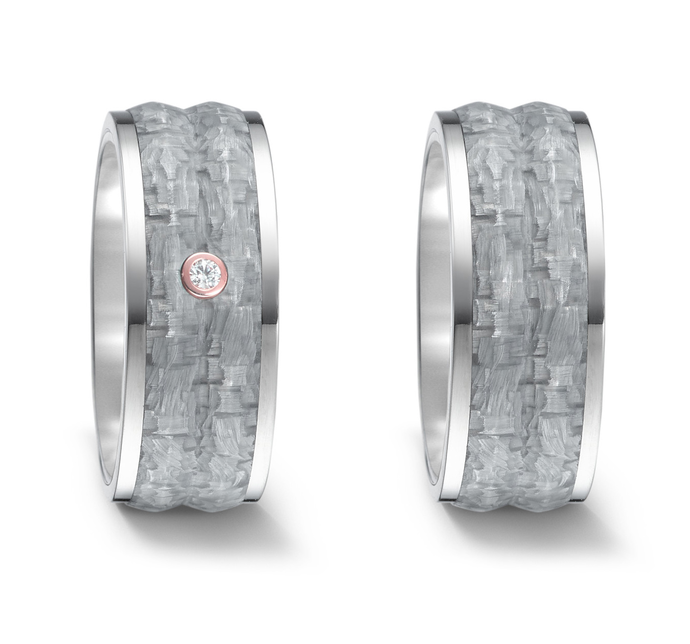Wedding rings or friendship rings in titanium and gray carbon with a little diamond.