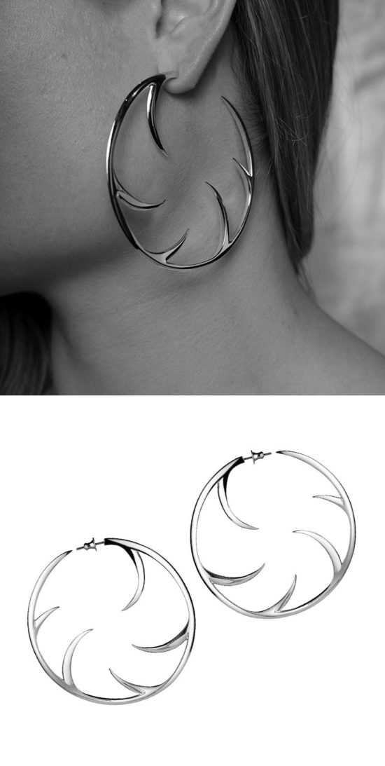 Large silver cat claw earrings.
