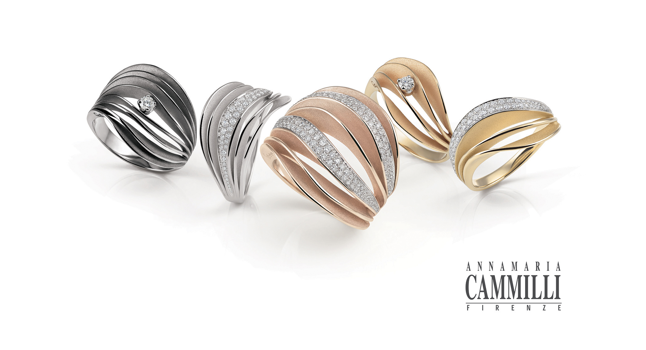 Five 18 carat golden rings with diamonds from the Velaa collection by Annamaria Cammilli.