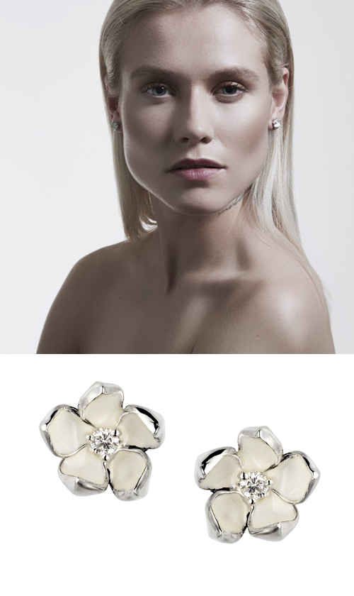 Silver earrings with a flower inspired by a white Japanese cherry blossom, finished with a diamond and white enamel.