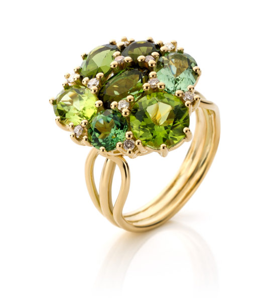 18 carat yellow gold ring with five green tourmalines, two peridots and small brown diamonds.