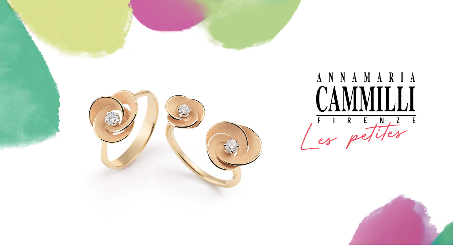 Two 18 carat gold rings with playful design flowers.